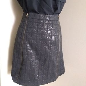 Textured black mini skirt with dual front zippers